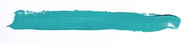 Turquoise brush stroke isolated over white background
