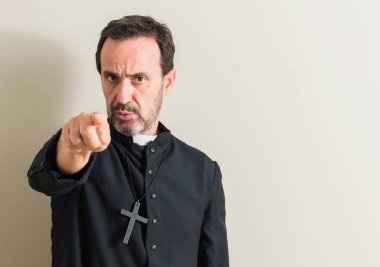 Senior priest religion man pointing with finger to the camera and to you, hand sign, positive and confident gesture from the front