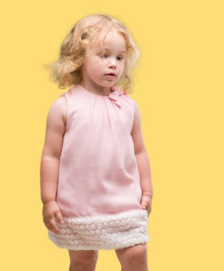 Beautiful blonde toddler gesturing