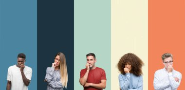 Group of people over vintage colors background looking stressed and nervous with hands on mouth biting nails. Anxiety problem.