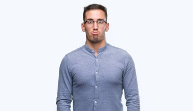 Handsome young elegant man wearing glasses depressed and worry for distress, crying angry and afraid. Sad expression.