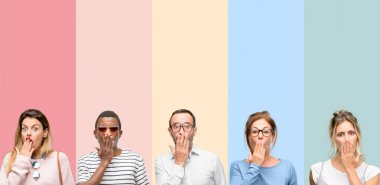 Mixed group of people, women and men covers mouth in shock, looks shy, expressing silence and mistake concepts, scared