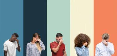Group of people over vintage colors background tired rubbing nose and eyes feeling fatigue and headache. Stress and frustration concept.