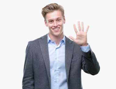 Young handsome blond business man showing and pointing up with fingers number five while smiling confident and happy.