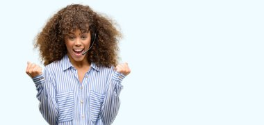 African american call center operator woman screaming proud and celebrating victory and success very excited, cheering emotion