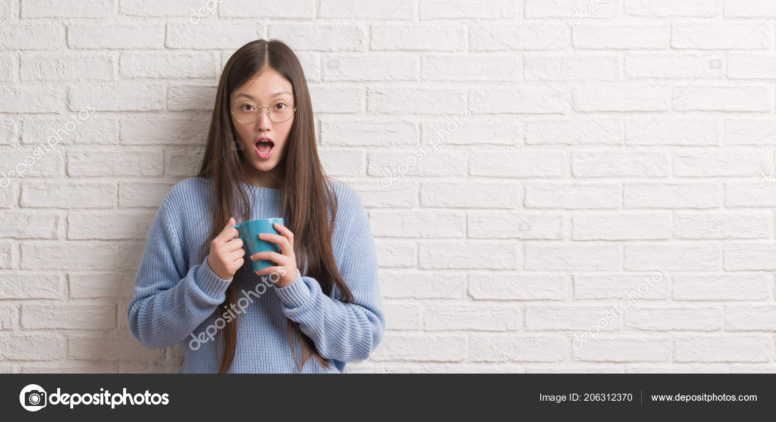 Young Chinise Woman Drinking Cup Coffee White Brick Wall