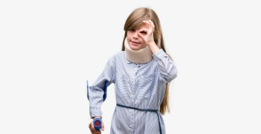 Young blonde child injured wearing neck collar and crutches with happy face smiling doing ok sign with hand on eye looking through fingers