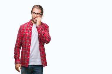 Young handsome man with long hair wearing glasses over isolated background looking stressed and nervous with hands on mouth biting nails. Anxiety problem.