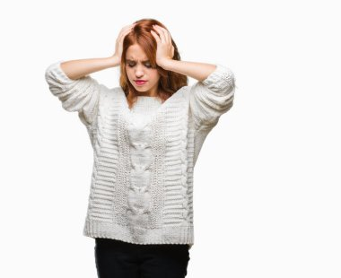 Young beautiful woman over isolated background wearing winter sweater suffering from headache desperate and stressed because pain and migraine. Hands on head.