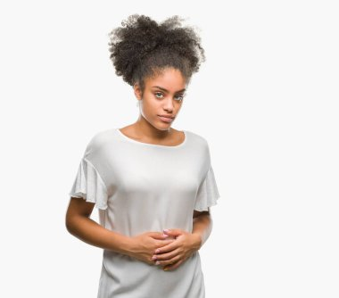 Young afro american woman over isolated background with hand on stomach because nausea, painful disease feeling unwell. Ache concept.