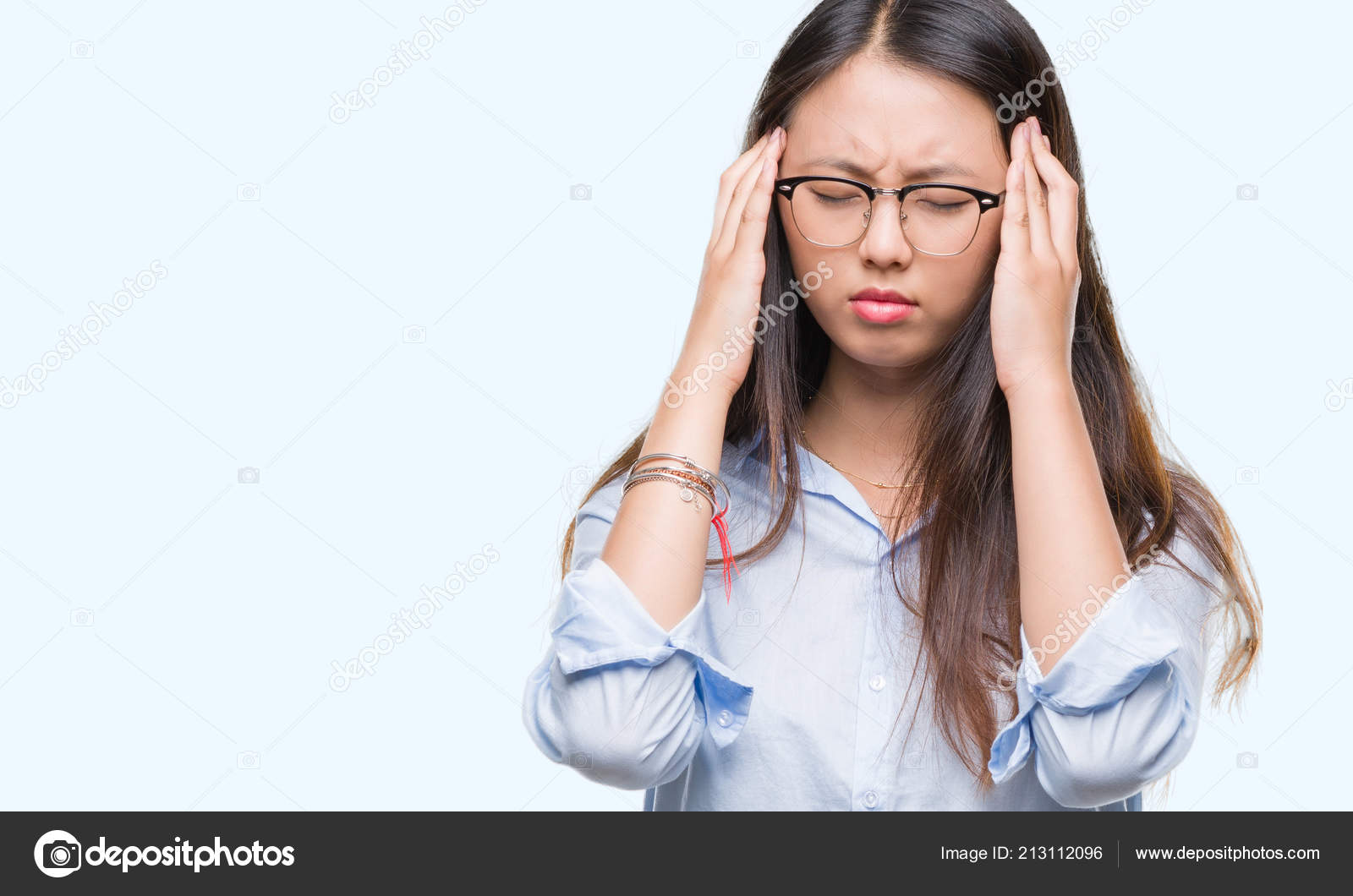 43ce4d50bb7 Young asian business woman wearing glasses over isolated background with  hand on head for pain in head because stress. Suffering migraine.