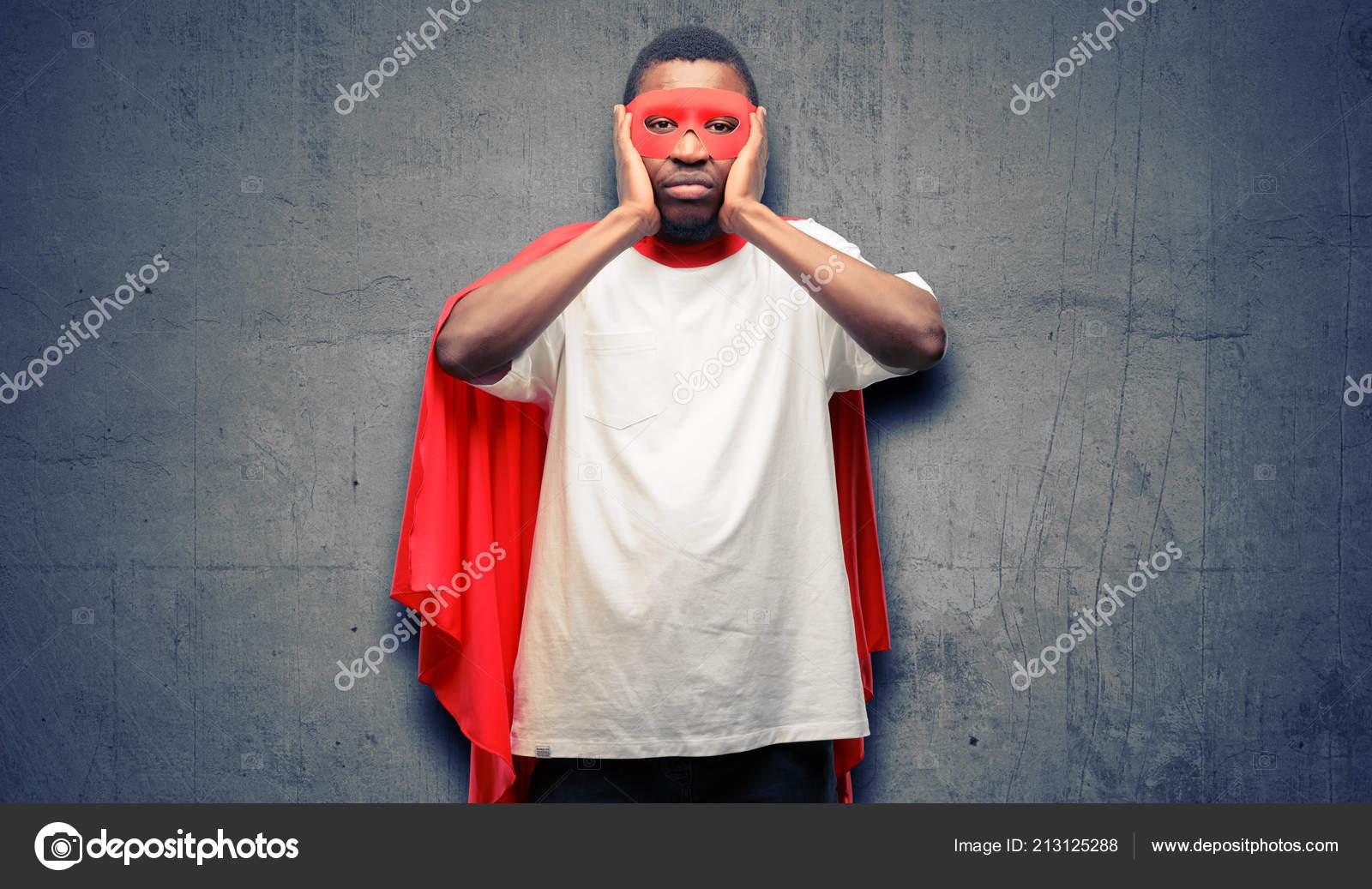 African Black Super Hero Man Covering Ears Ignoring Annoying Loud