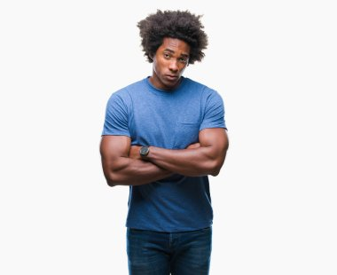 Afro american man over isolated background skeptic and nervous, disapproving expression on face with crossed arms. Negative person.