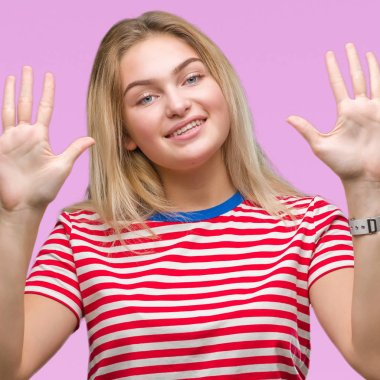 Young caucasian woman over isolated background showing and pointing up with fingers number ten while smiling confident and happy.