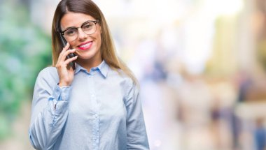 Young beautiful business woman speaking calling using smartphone over isolated background with a happy face standing and smiling with a confident smile showing teeth