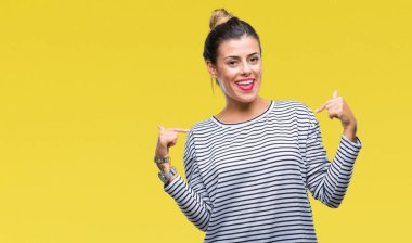 Young beautiful woman casual stripes sweater over isolated background looking confident with smile on face, pointing oneself with fingers proud and happy.