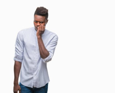 Young african american man over isolated background looking stressed and nervous with hands on mouth biting nails. Anxiety problem. stock vector