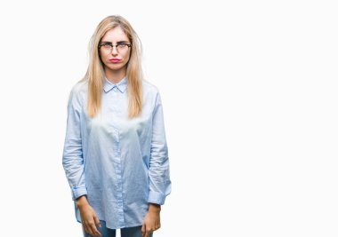 Young beautiful blonde business woman wearing glasses over isolated background depressed and worry for distress, crying angry and afraid. Sad expression.