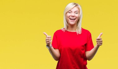Young beautiful blonde woman wearing red t-shirt over isolated background success sign doing positive gesture with hand, thumbs up smiling and happy. Looking at the camera with cheerful expression, winner gesture.