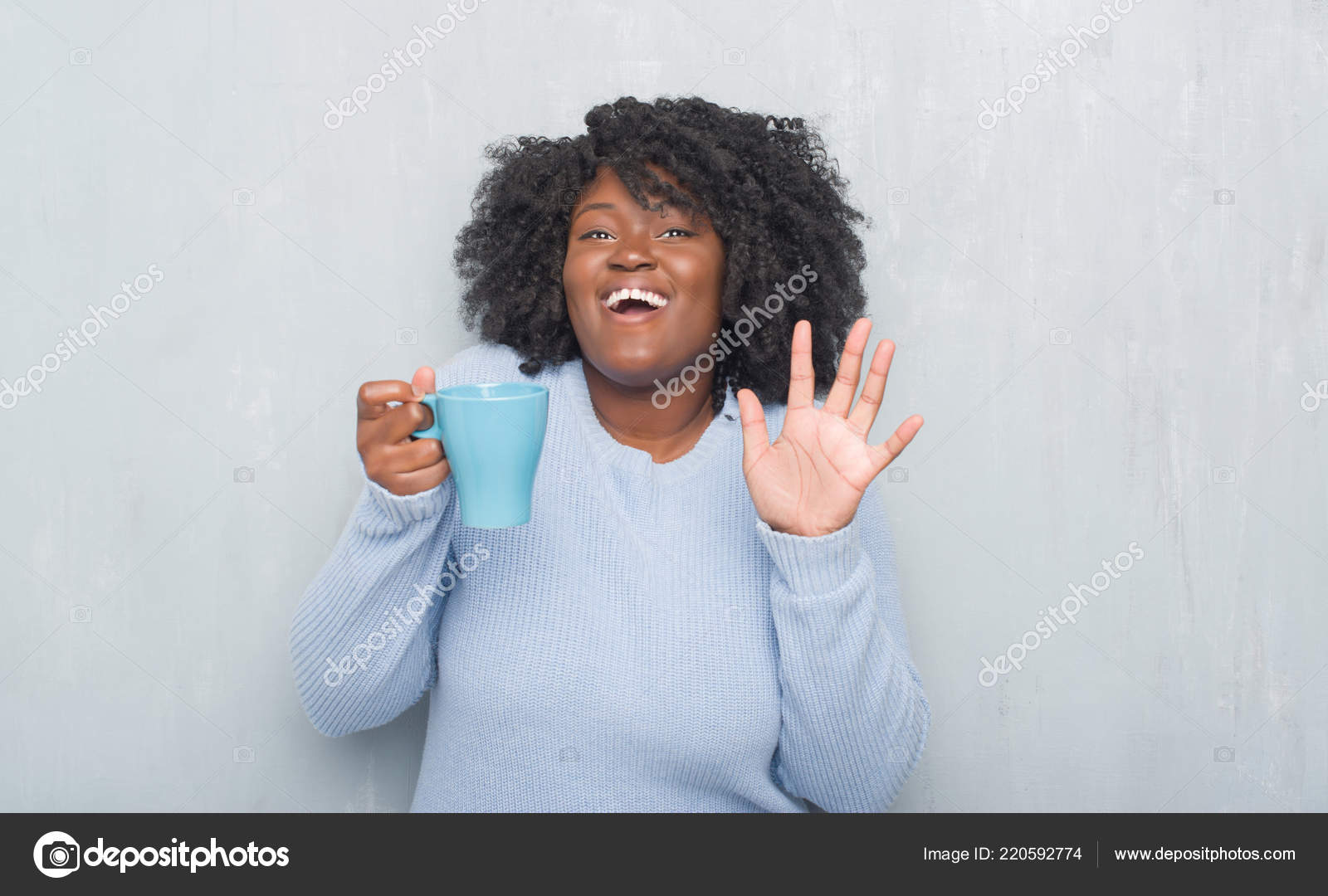 f29d14a57f2 Young african american woman over grey grunge wall drinking a cup of coffee  very happy and excited, winner expression celebrating victory screaming  with big ...
