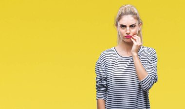 Young beautiful blonde woman wearing stripes sweater over isolated background touching mouth with hand with painful expression because of toothache or dental illness on teeth. Dentist concept.