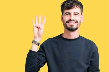 Young handsome man over isolated background showing and pointing up with fingers number four while smiling confident and happy.