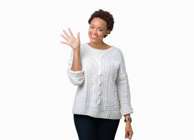 Beautiful young african american woman wearing sweater over isolated background showing and pointing up with fingers number five while smiling confident and happy.