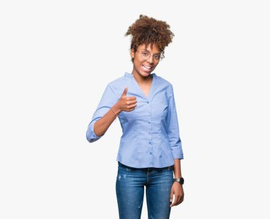 Beautiful young african american business woman over isolated background doing happy thumbs up gesture with hand. Approving expression looking at the camera showing success.