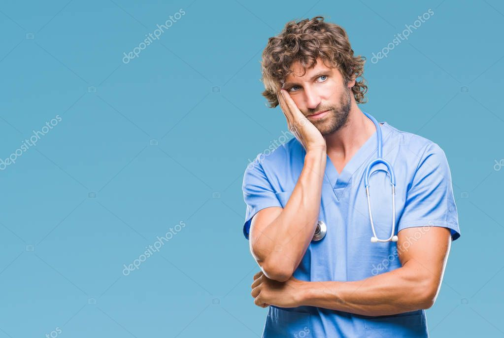 Handsome hispanic surgeon doctor man over isolated background thinking looking tired and bored with depression problems with crossed arms.