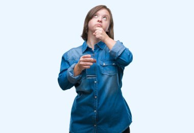 Young adult woman with down syndrome drinking water over isolated background serious face thinking about question, very confused idea