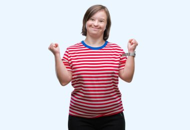 Young adult woman with down syndrome over isolated background excited for success with arms raised celebrating victory smiling. Winner concept.