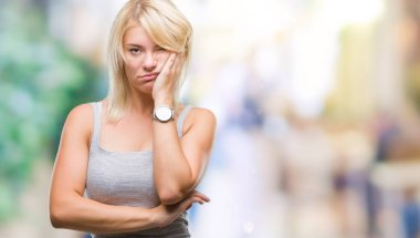 Young beautiful blonde woman over isolated background thinking looking tired and bored with depression problems with crossed arms.