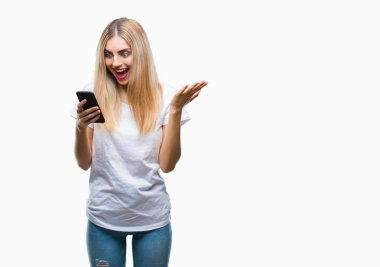 Young beautiful blonde woman using smartphone over isolated background very happy and excited, winner expression celebrating victory screaming with big smile and raised hands