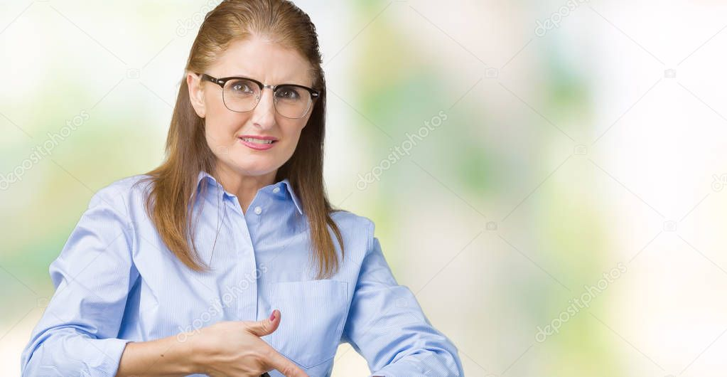 Positive Redhead Businesswoman Pointing With Finger And Looking