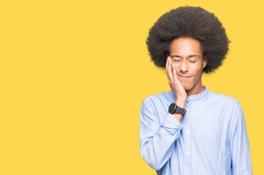 Young african american man with afro hair touching mouth with hand with painful expression because of toothache or dental illness on teeth. Dentist concept.
