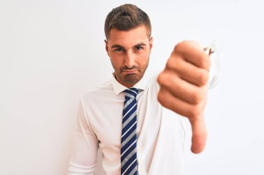 Young handsome elegant business man over isolated background looking unhappy and angry showing rejection and negative with thumbs down gesture. Bad expression.