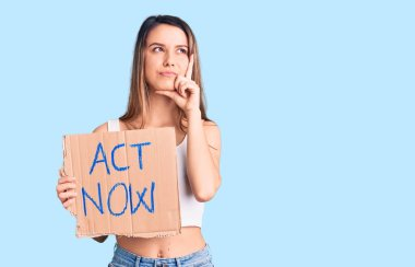 Young beautiful girl holding act now banner serious face thinking about question with hand on chin, thoughtful about confusing idea stock vector