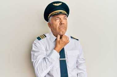 Handsome middle age mature man wearing airplane pilot uniform touching painful neck, sore throat for flu, clod and infection