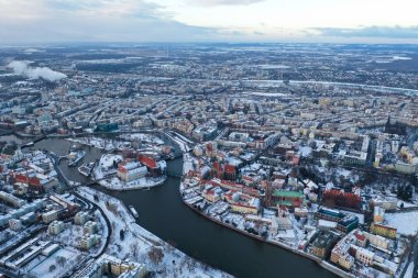 Wroclaw, Poland - January 3, 2019: Aerial view of city centre including Cathedral, Odra River, Churches and other buildings after a snowfall