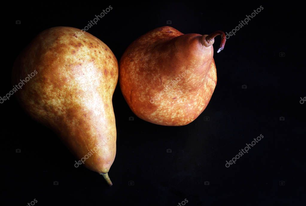 appetizing juicy pears on a black background
