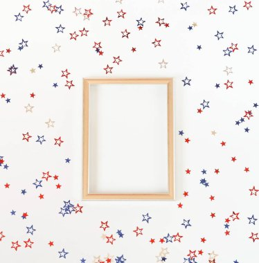 4th of July American Independence Day blue and red stars decorations, frame mock up on white   background. Flat lay, top view, copy space.Red and blue stars border for American Independence