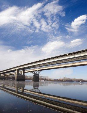 Bridge under river. Blue sky