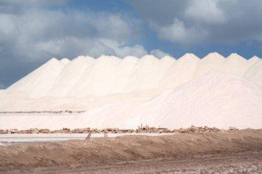 Salt production. Salt mountains against the blue sky.