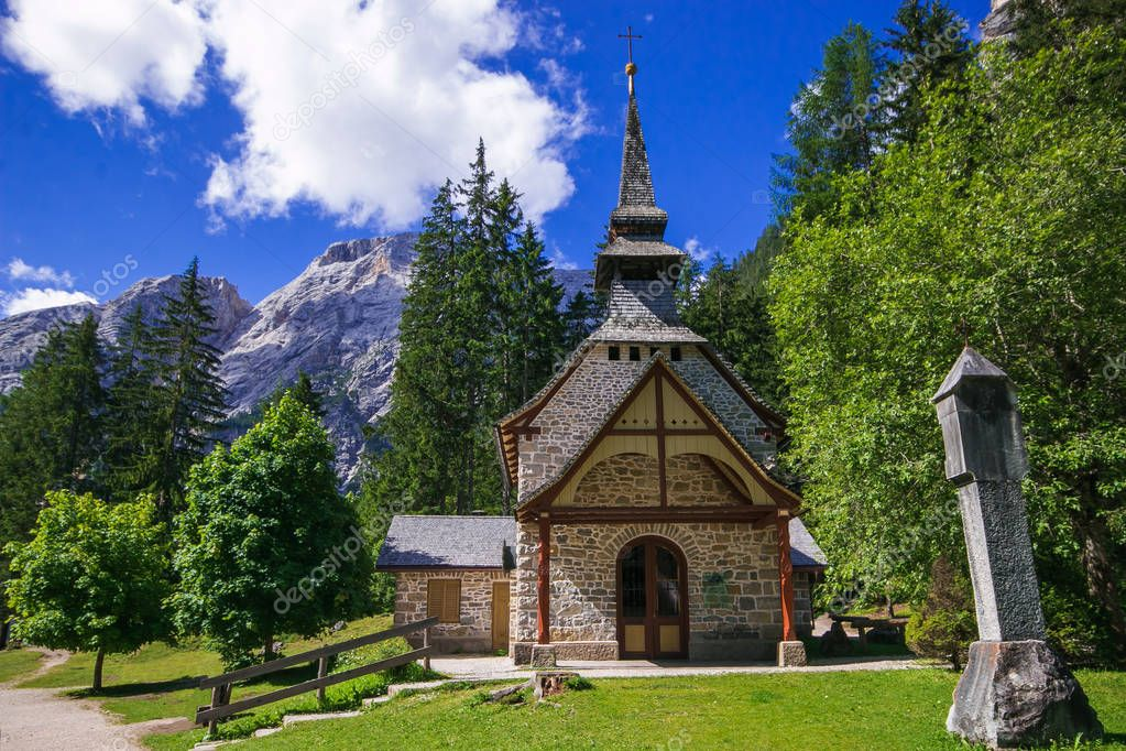 Little chapel at the Braies Lake ( Pragser Wildsee ) in Dolomites mountains Sudtirol Italy