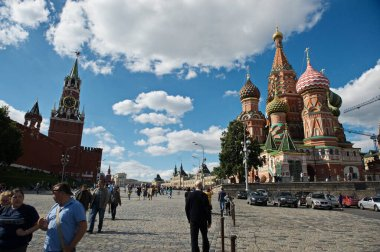 Moscow / Russia-06.22.2014: Red Square and its architecture. Residents and guests of the city walk around the territory.