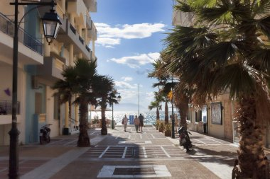 LOUTRAKI, GREECE - JUNE 28, 2018: On the street of Loutraki on a summer day with clouds