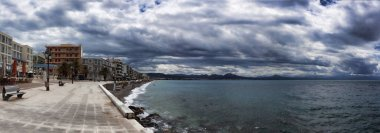 LOUTRAKI, GREECE - JUNE 27, 2018: The embankment of Loutraki on a cloudy summer day. Panoramic view