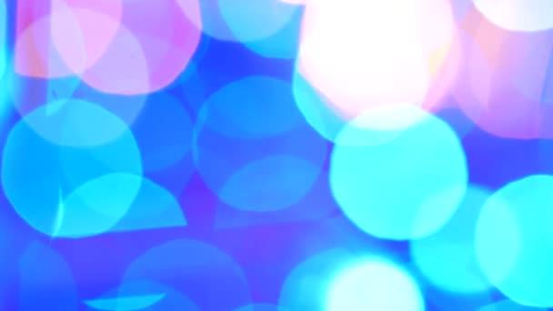 Abstraktní pozadí s zářící modré bokeh jiskří