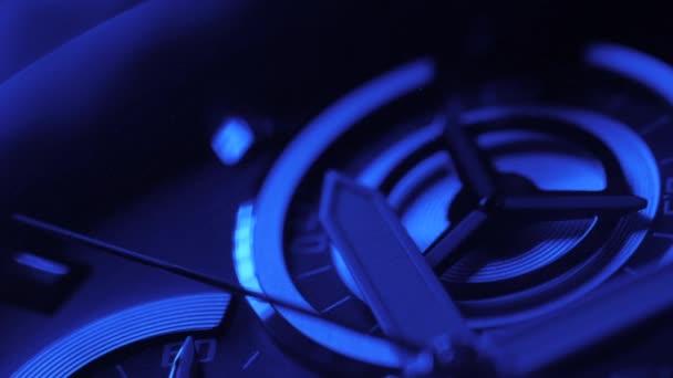 Luxury man watch detail, chronograph close up. Blue neon light.