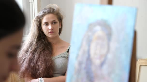 Woman Artist In Gloves Painting Picture Of Young Curly Haired Girl With Oil Paints Process Of Working Talented Girl In Studio Mixing Colors Together Model Poses For Art 4k